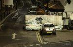 pixel stick image of hokusai behind a car